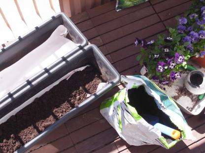 If you put thin paper (or newspaper) on top of the drainage gravel and then the soil, the soil won't mix with the gravel.